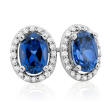 Stud Earrings with Created Sapphire & 1/6 Carat TW of Diamonds in 10kt White Gold