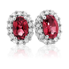 Stud Earrings with Created Ruby & 1/5 Carat TW of Diamonds in 10kt White Gold
