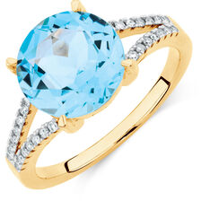 Ring with Blue Topaz & 1/10 Carat TW of Diamonds in 10kt Yellow Gold