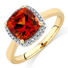 Ring with Created Orange Sapphire & 1/15 Carat TW of Diamonds in 10kt Yellow Gold
