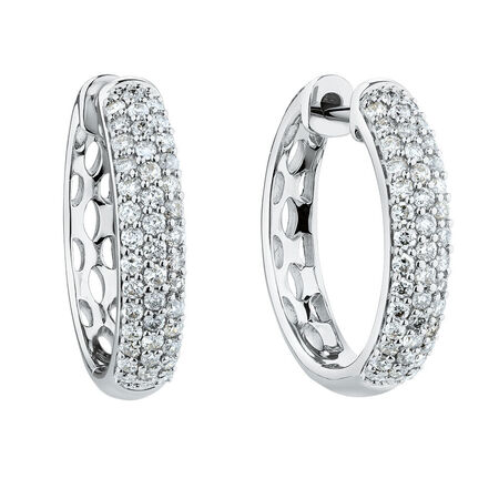 Huggie Earrings With 0.60 Carat TW Of Diamonds In 10kt White Gold