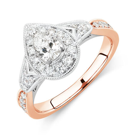 Sir Michael Hill Designer GrandAmoroso Engagement Ring with 0.71 Carat TW of Diamonds in 14kt White & Rose Gold