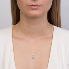 Pendant with Blue Topaz in 10kt White Gold