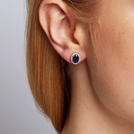 Stud Earrings with Created Sapphire & 1/10 Carat TW of Diamonds in 10kt White Gold