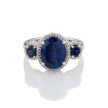 Three Stone Ring with Created Blue Sapphire & 1/5 Carat TW of Diamonds in 10kt White Gold