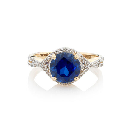 Online Exclusive - Ring with 0.15 Carat TW of Diamonds & Created Blue Sapphire in 10kt Yellow Gold