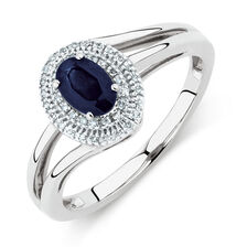 Ring with Blue Sapphire & 1/15 Carat TW of Diamonds in 10kt White Gold