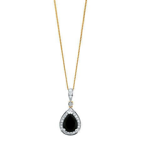 Pendant with Sapphire & 1/6 Carat TW of Diamonds in 10kt Yellow & White Gold