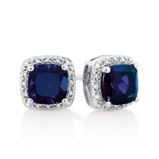 Earrings with Created Sapphire & 1/12 Carat TW of Diamonds in 10kt White Gold
