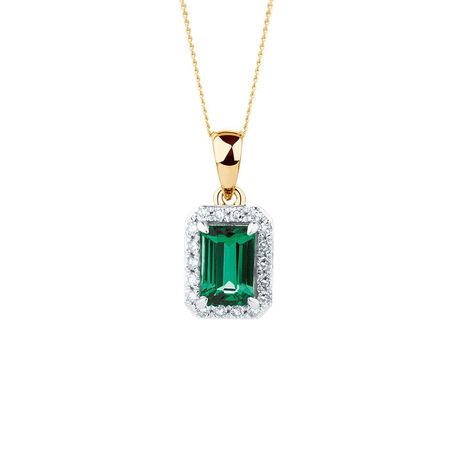 Pendant with Created Emerald and 1/10 Carat TW of Diamonds in 10kt Yellow Gold